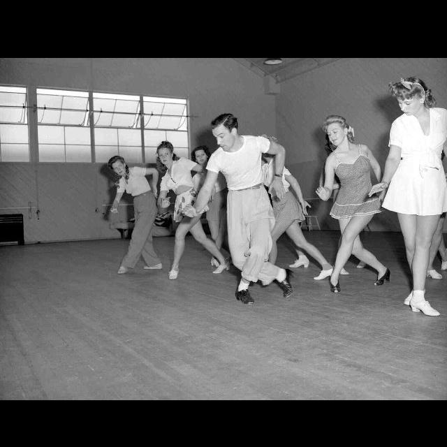 Gene Kelly rehearsing with the chorus.