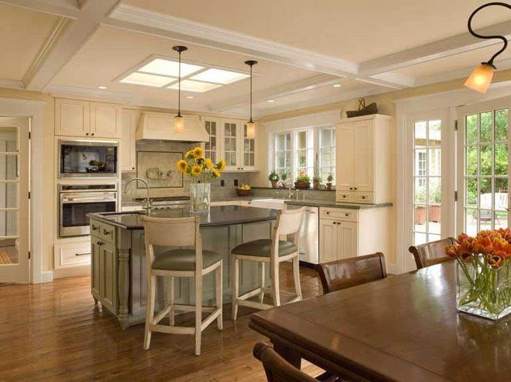 Remodeled Kitchen Dining Area With A Skylight Over The Island