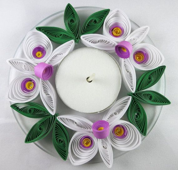This beautiful candle holder features hand quilled orchids in white, purple and yellow. The quilled design is mounted to a clear acrylic plate
