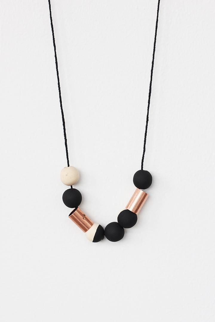 Make this handmade wood bead necklace with copper beads from the hardware store. Perfectly fashionable for Fall!