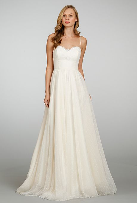 Brides: Blush by Hayley Paige. Ivory natural waist a-line Swiss dot net bridal gown with spaghetti straps and lace detailing at bust, plunging back and chapel train.