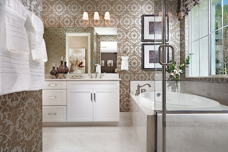 Metallic floral wallpaper, glass shower enclosure, marble tub tile—what's your favorite feature? | Nicholas model home | Inland Empire | Richmond American Homes