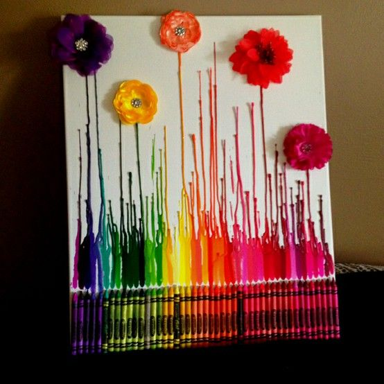 """Love the addition of the flowers! """"I just hot glued the crayons on and picked up some flowers from Michael's. I used a heat gun because a hair dryer seemed to splatter it everywhere and the heat gun gave it straight lines. Once the wax dried (which wasn't long) I hot glued the flowers on. Super Easy! :)"""""""