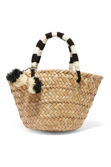 Kayu's 'St Tropez' tote is skilfully woven from natural seagrass by local artisans using traditional techniques. This structured, lightweight bag has black and white striped handles and matching bohemian-inspired pompoms. We think it's perfect for days in the city or vacations.