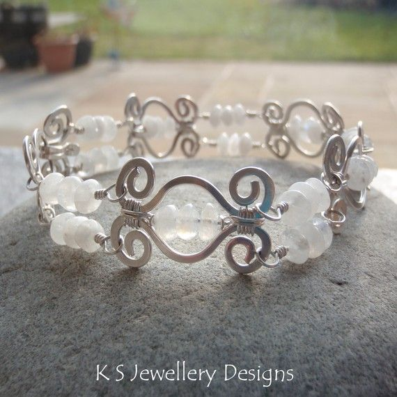 This wire jewelry tutorial has detailed instructions (43 pages, 112 steps with 112 close-up photographs) to show you how to create a beautiful HAMMERED SWIRL LINK BRACELET with a matching 'swirl clasp'. The step by step lesson includes clear instructions on creating spirals, shaping and hammering wire and wire wrapping techniques. MATERIALS YOU WILL NEED: 18 gauge soft round wire 24 gauge soft round wire 26 gauge soft round wire Rondelle beads (NB. Plated wire is NOT suitable for the…