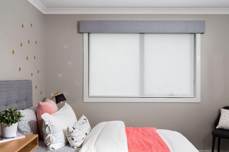 Grey coloured pelmet and white coloured translucent roller blind.                                                                          |                                                                          Window Furnishing: Roller Blinds                                                                          |                                                                          Room: Bedroom