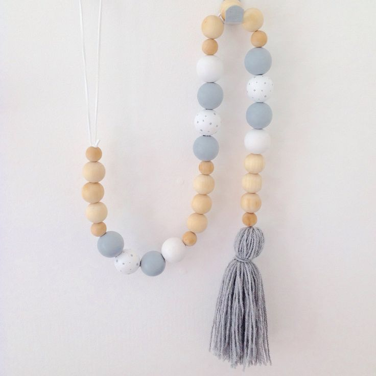 Wooden bead garland available in a range of colour options to suit any styling