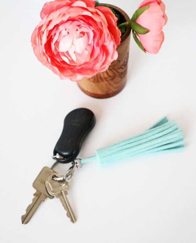 Leather tassels are great for accentuating plain accessories. Check out this simple DIY leather tassel tutorial from DIYS.com and give your wallet, purse or keychain a little pop of color.