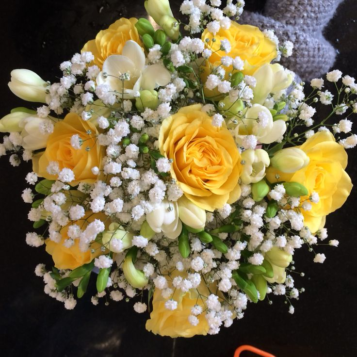 Yellow wedding flowers Yellow roses with freesia and gyp Hand tied wedding flowers Gypsophila is back in fashion!! Love this bridal bouquet it has a dreamy, casual feel.
