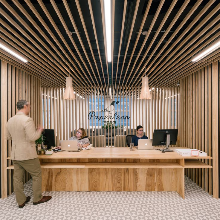 Architecture firm +ADD has used ash louvers and exposed ceilings to provide a bright workspace for Paperless Post's new headquarters in New York.