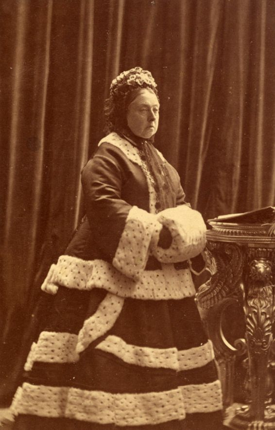 Queen Victoria in 1872. After the death of the Prince Consort the Queen emerged from seclusion only when obliged to - usually to attend the dedication of a memorial to her dead husband ( or in this instance to attend a service of thanksgiving for the recovery of the Prince of Wales from typhoid) . This is a fair example of the kind of souped up mourning (with regal trimmings) she decided to adopt. Variations of this look would take her to the end of her life.