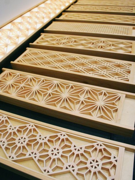 """Japanese """"Border Kumiko"""" by Yoshihara Wood Works. Designer Keiji Yoshihara, from Misumi Town in Shimane Prefecture, has mastered the technique of kumiko: creating pattern & form from precisely cut, interlocking strips of wood, a method that is over 800 years old,  """"Border Kumiko,"""" can serve as subtle lighting, elegant trim or more overt decorative wall-mounted elements."""