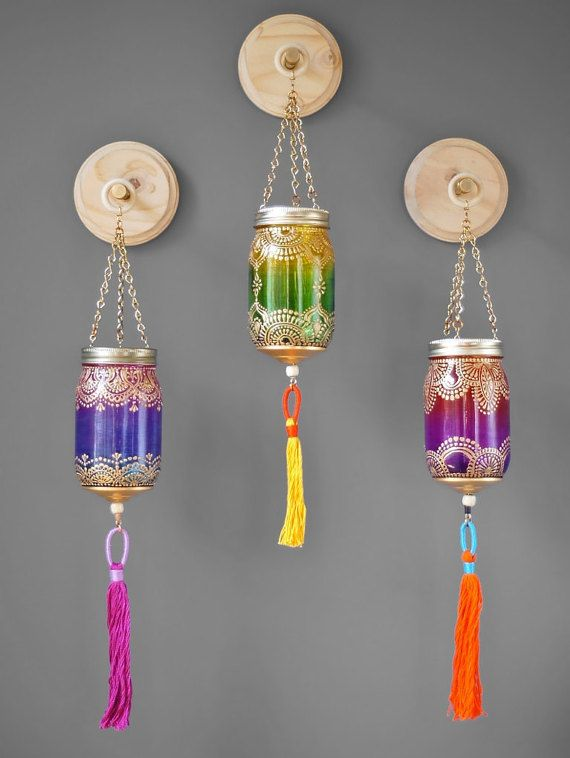 Boho Chic Wall Decor, 3 Mason Jar Decor Hanging Lanterns with Luxe Handmade Tassels, Natural Wood Plaques With Mixed Metal Display Hooks  This listing is for 3 hand made 16 oz mason jar lanterns, customized with brass hardware and individually crafted embroidery floss tassels, each with their own circular raw wood wall plaques and 4 inch brass and steel hooks to be displayed from. Each glass lantern is customized with ombre glass colors; one with teal to lemon glass tint, one with turquoise…