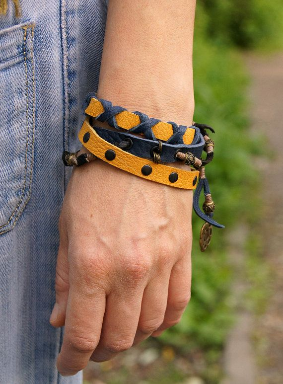 Bracelets Out of Line made of leather, wax cord and metal elements. Available in two versions.