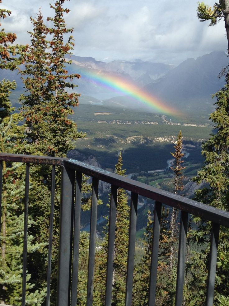 rainbow sighting on a mountain in banff, alberta, canada.