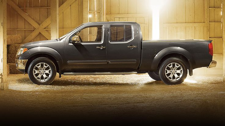 2015 Nissan Frontier truck crew cab side view in night armor color shown in barn