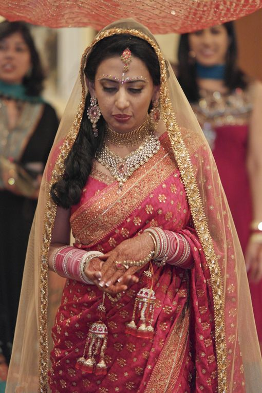 Pink bridal sari with gold dupatta