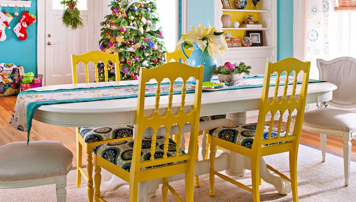 Love this table and the 2 different sets of chairs and the bright yellow color. All of it.