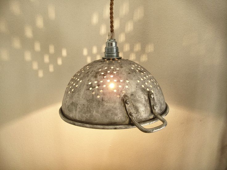 upcycled battered and weathered colander lamp via etsy