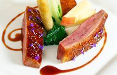 Roast crown of duck with turnip, peach, duck croustillant and red wine jus