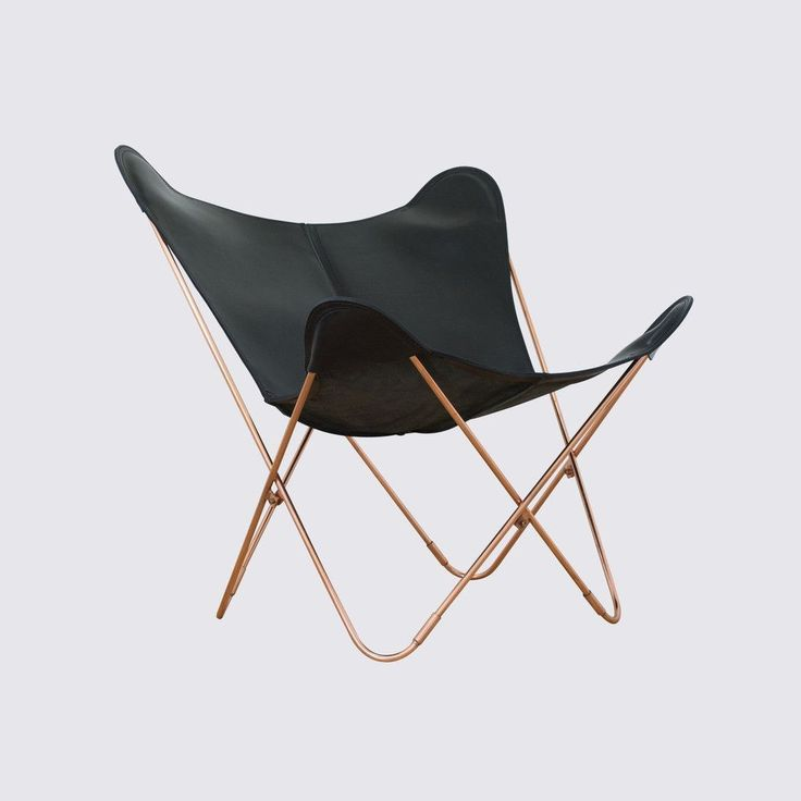 A Modern Take On The Iconic Leather Butterfly Chair, Featuring Sleek Black  Leather Juxtaposed With