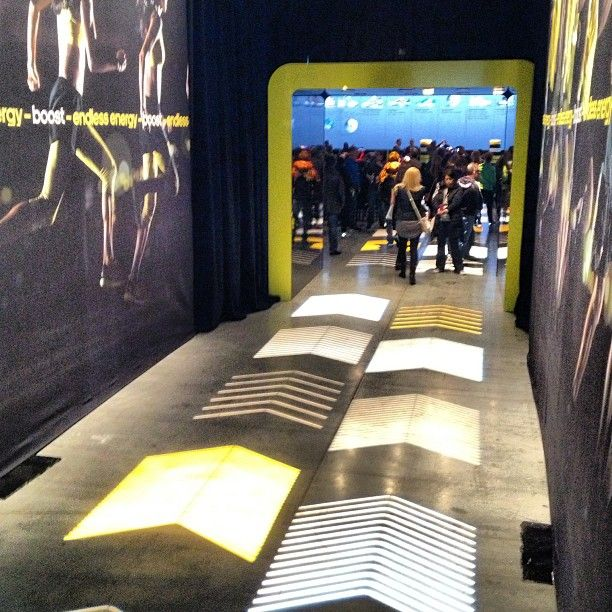 Projected lighting guides guests to #adidas' presentation to reveal new footwear innovation #boost #NYC  This would be cool and pretty easy to do with Vinyl Stickers on the floor! We could do more than just arrows too.
