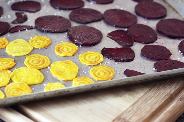 Crispy baked beet Chips - Preheat oven to 350º F.  Toss beets slices with oil in a medium sized bowl until they are all well coated and lay them flat in a single-layer on a rimmed baking sheet (bake in multiple batches, if necessary).  Bake for 20-30 minutes, until chips are crispy