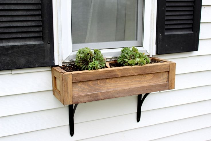 So I ended up making all three window boxes for $15 since I had all the wood. And here's the end result.