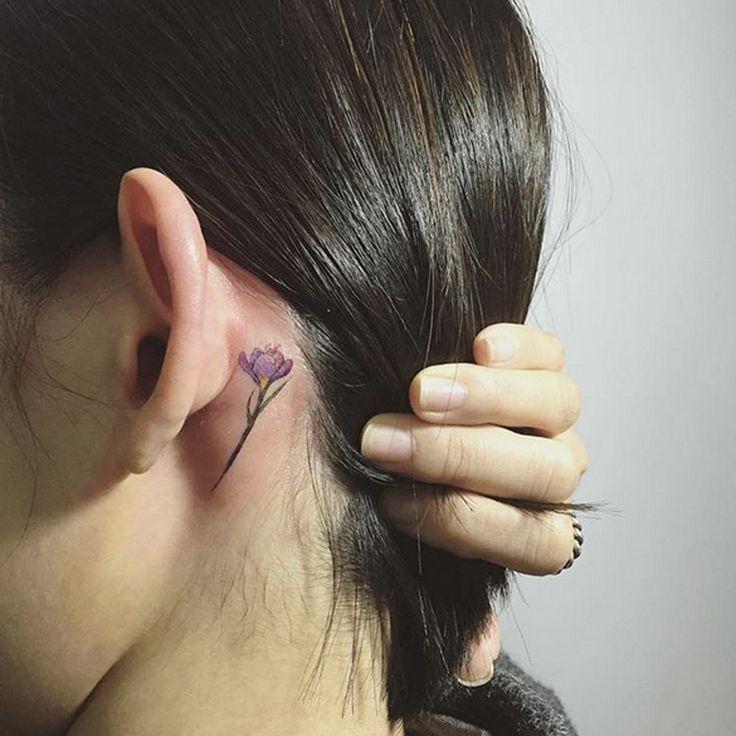 Delicate flower tattoo idea.