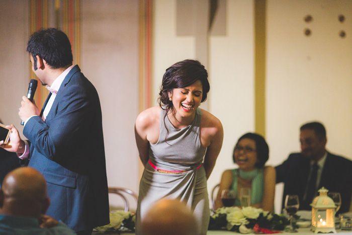 bride laughing at groom speech