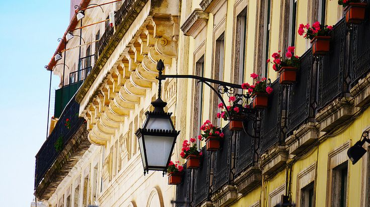 Lisbon traditional windows and an old 1948 street lamp