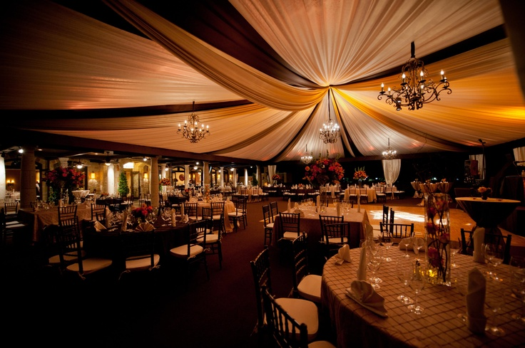 Full Ceiling Liner Draping with Rustic Chandeliers and amber lighting