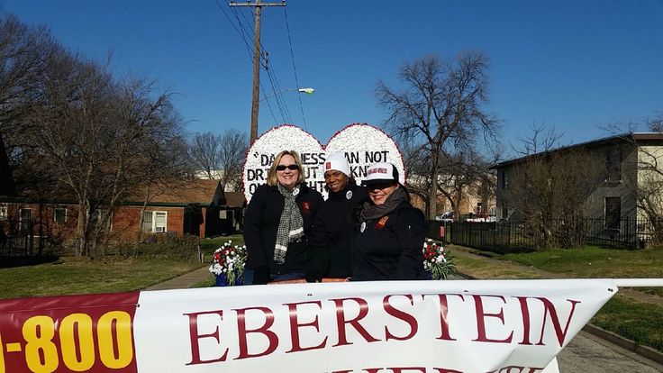 Lucy holding the #1800carwreck banner with Carson & Tascha #mlkparade #1800carwreck #ebersteinwitherite