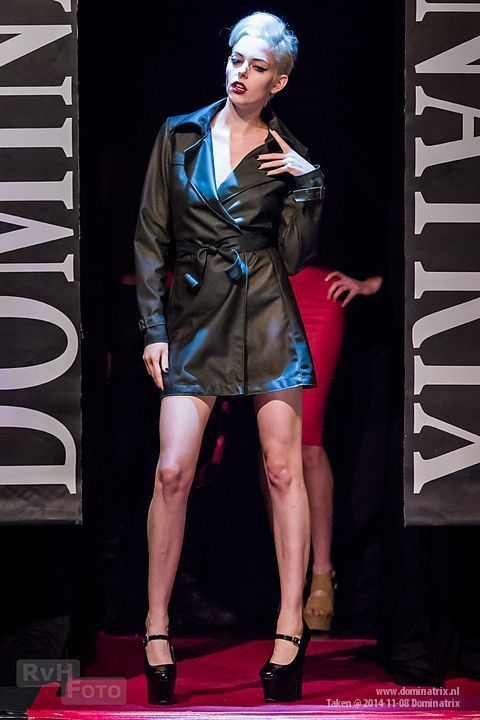 Trench coat at the Dominatrix show.