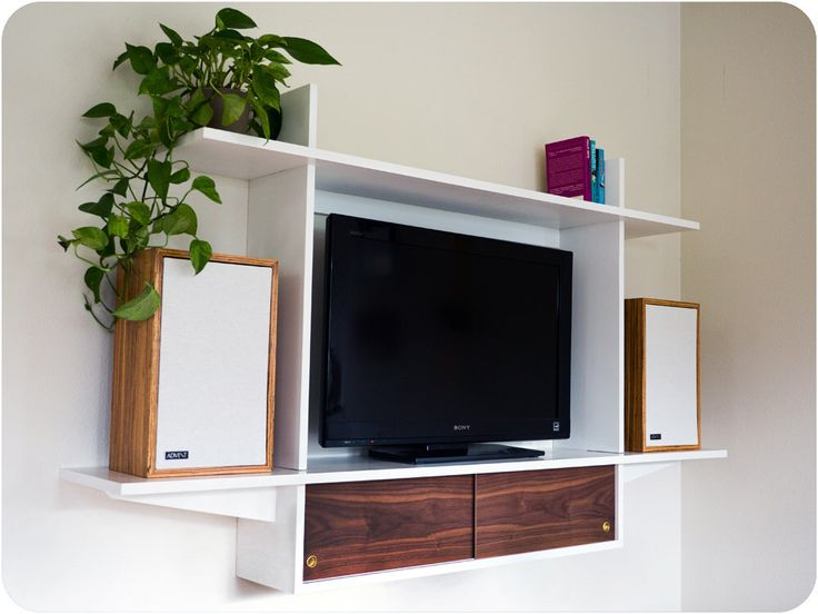 Floating Television Console With Sliding Doors - Mid Century Modern Inspired by GraceModern on Etsy https://www.etsy.com/listing/210626370/floating-television-console-with-sliding