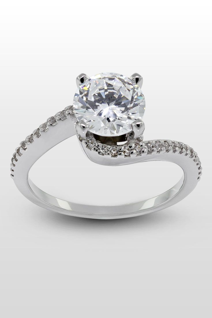 Cecily Engagement Ring  A Swirled Accented Band Hugs The Round Cut Center  Stone Of This