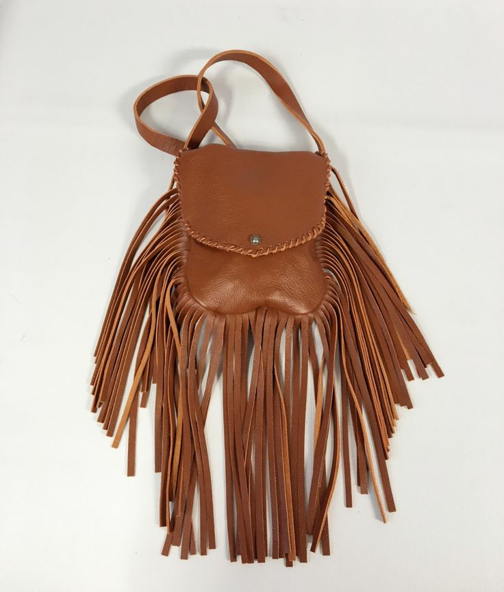 A personal favorite from my Etsy shop https://www.etsy.com/listing/474588000/fringe-boho-leather-purse-brown-fringe