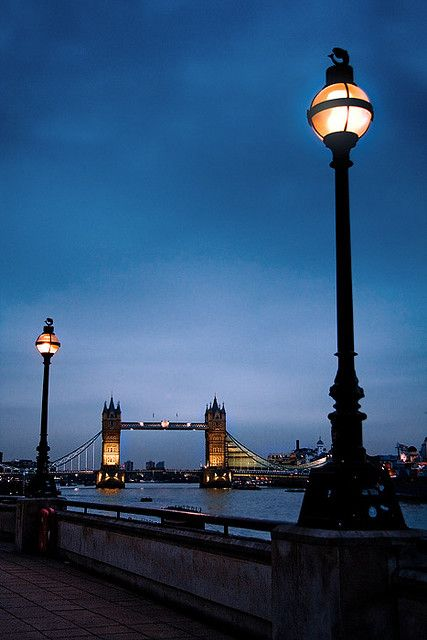 The London Tower Bridge framed by two street lamps.