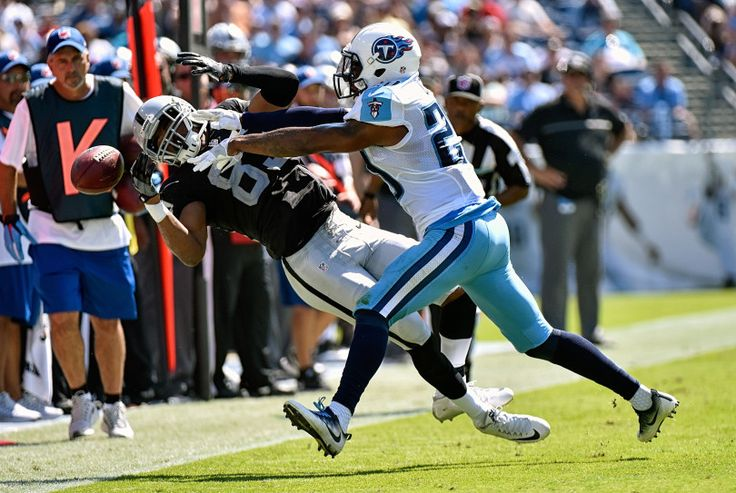 Perrish Cox #20 of the Tennessee Titans pushes Amari Cooper #89 of the Oakland Raiders out of bounds causing an incompletion during the first half at Nissan Stadium on September 25, 2016 in Nashville, Tennessee.  (Photo by Frederick Breedon/Getty Images)