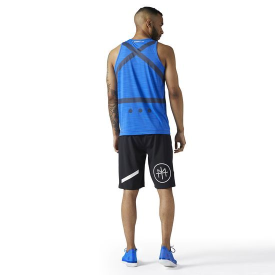 Reebok - LES MILLS ACTIVCHILL Tank: Step into the studio and get to work with this LES MILLS ACTIVCHILL tank. Sweat becomes an afterthought thanks to Speedwick tech, and you'll stay cool and dry as you achieve new personal bests. Bold graphics bolster the overall style.