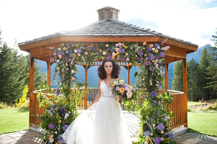 bride at the Silvertip wedding gazebo captured by Calgary wedding photographer Tara Whittaker | Canmore, Alberta