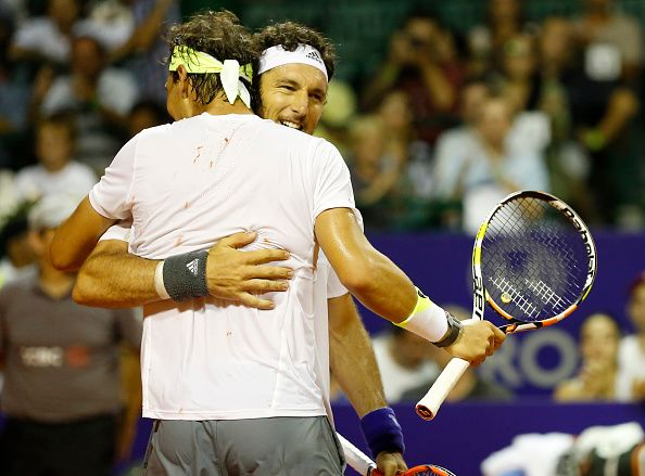 Juan Monaco of Argentina and Rafael Nadal of Spain celebrate after wining the dobles match between Frantisek Cermak and Jiri Vesely of Czech Republic and Juan Monaco of Argentina and Rafael Nadal of Spain as part of ATP Argentina Open at Buenos Aires Lawn Tennis Club on February 24, 2015 in Buenos Aires, Argentina. (Photo by Gabriel Rossi/LatinContent/Getty Images)