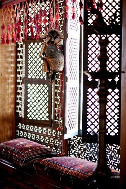 Traditional Indian wooden craftsmanship. These wooden jaali (lattice) windows are a very traditional feature of Indian homes.