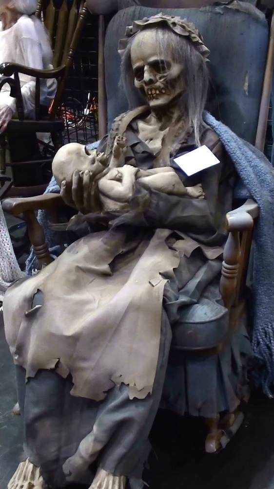 I want this.  Saw this at Halloween Express - doesn't come with the rocking chair, but prop does rock back and forth.