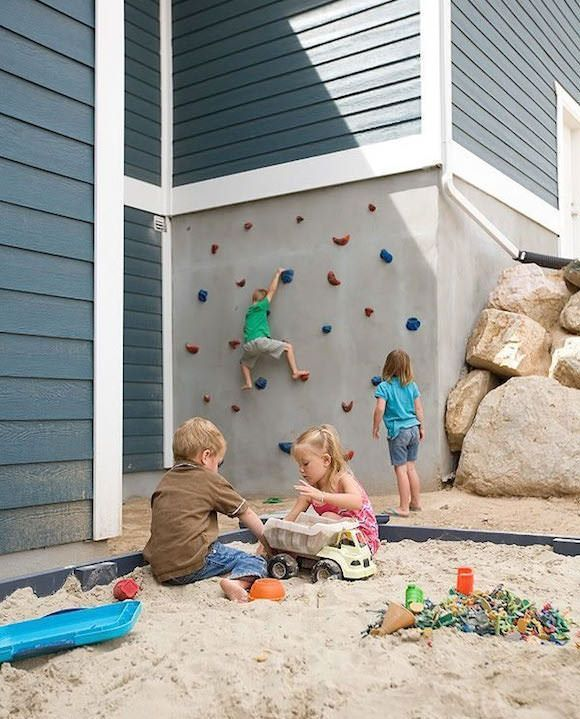 not sure what to do with your walls in your outdoor for your kids? Then a mini climbing wall is just the thing. once your kids have outgrown the wall, you can take down the grips, plaster over and do something else with the space. #outdoorliving #kidsspace