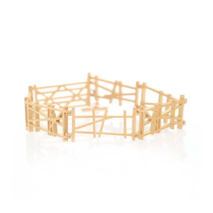 """Ben Kelly's """"Don't Fence Me In"""" bracelet in gold plated sterling silver for Eiger Gallery"""