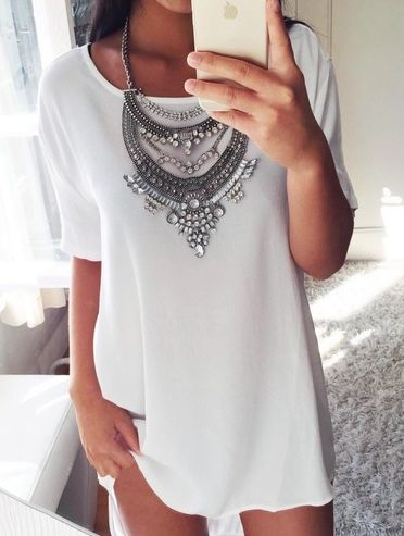 Simple silk shift dress with short sleeves, topped off with a gorgeous rhinestone necklace!
