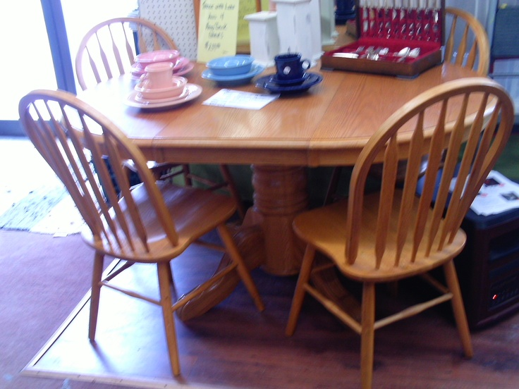 "4 hoop back chairs with 42"" round table ped. base in light oak has a 18"" leaf  $ 299 for the set"