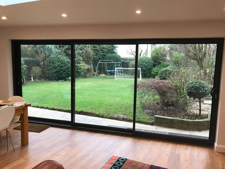Smarts System aluminium triple track patio door in RAL7016 anthracite grey. Installed in Edwalton, Nottingham. For a free quotation call us on 01158 660066 visit our website http://www.thenottinghamwindowcompany.co.uk/ or pop into our West Bridgford showroom. #Aluminium #Home #Ideas #Nottingham