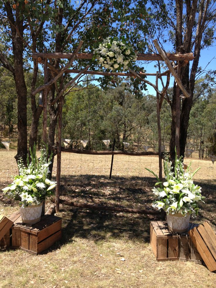 the ceremony rustic canopy & flowers